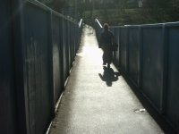 A friend walking along the bridge over Alexandra Palace station