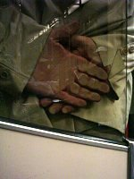 Hands squashed against glass.