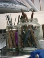 Jars of pencils and woodcutting tools. My heirloom.