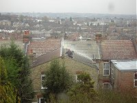 A builder on a roof.