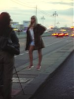 A woman posing as a prostitute for a photoshoot.