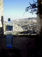 Bottled water. An old city.